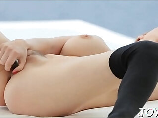 Solo beauty stimulates tits and twat