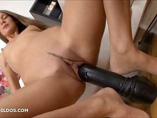 Thin brunette stretching her pussy fucking with thick dildos
