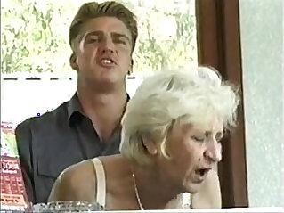 Ficky Martin fucks a blonde granny very hard on the hotel desk