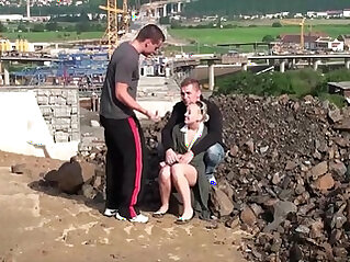 Cute little chick fucked in public construction site by guys with big dicks