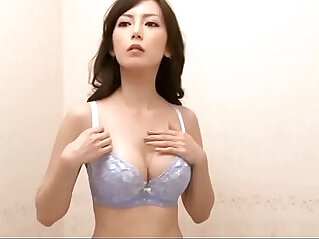 Very hot Japanese trying out bra