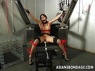 Busty brunette getting her wet pussy machine fucked