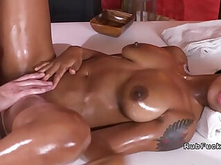 Ebony fucks masseur on table