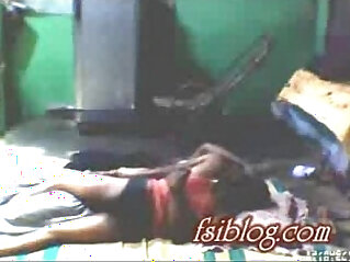 Village girl lying on floor with neighbor