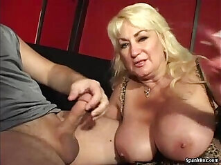 Busty mom gives a nice blowjob and smokes cigarette